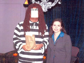ICE head Julie Myers at a 2007 Halloween party with an employee wearing a racially insensitive costume. The House Homeland Security Committee released this photo, and obscured the face of the costumed employee.