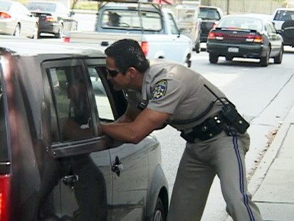 VIDEO: CHP officer catches drivers talking on cell phones.