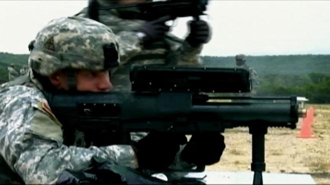 VIDEO: XM25 features programmable rounds to take out insurgents behind cover.