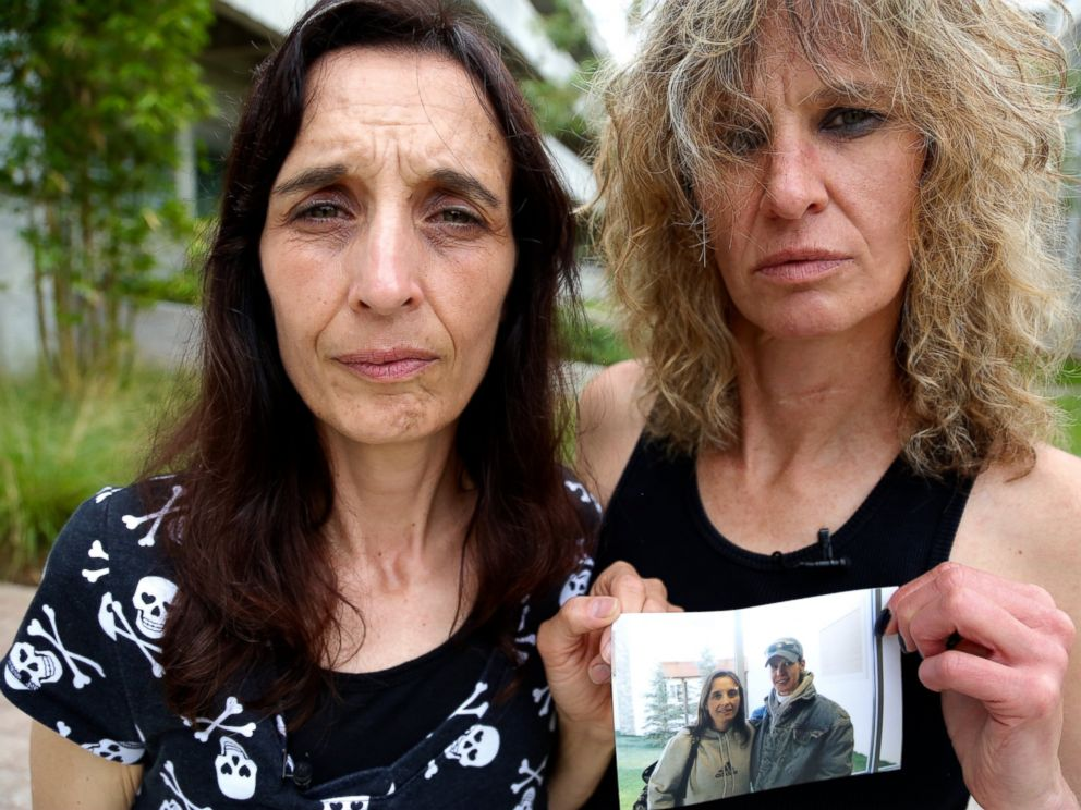 Leigh Erceg, right, and her friend Amber Anastasio, left, are shown here holding a picture of the two of them taken before Ercegs accident.