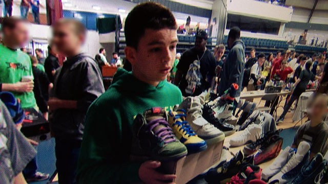 PHOTO: Alex Asfar, 15, from Middletown, N.J., barters limited edition Nikes at a sneakers convention in New York City.