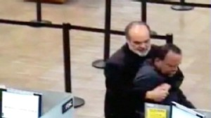 VIDEO: California professor Kim Komenich restrains a bank robber with a bear hug.