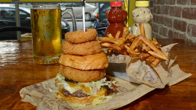 PHOTO: The Supreme Beef burgerseen here on a brioche bun with a side of Onion Rings and French fries, and a lionshead lager beer, is served at Bare Burger, Astoria Queens, July 25, 2012.