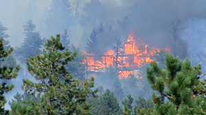 PHOTO A wildfire, which started today in Fourmile Canyon northwest of Boulder is threatening many homes.