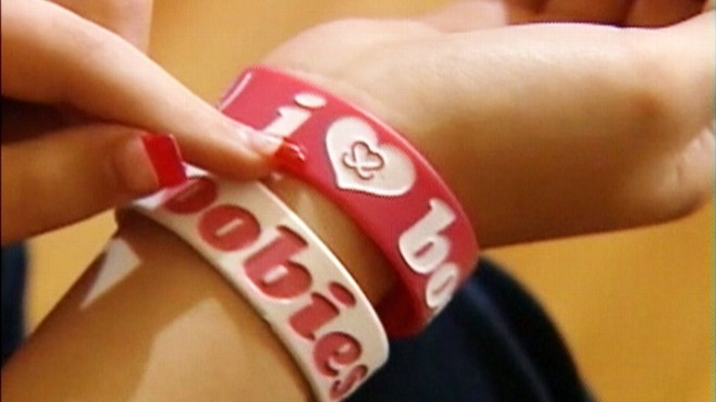 Video: School bans breast cancer awareness bracelets.