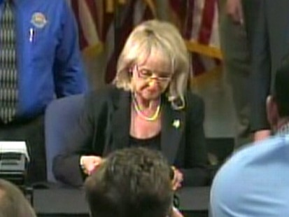 Video: Gov Brewer signs controversial bill.