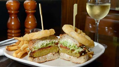 PHOTO: Burger and Barrel Winepub's Veggie burger is served with one of their signature white wines, July 25, 2012, New York City.