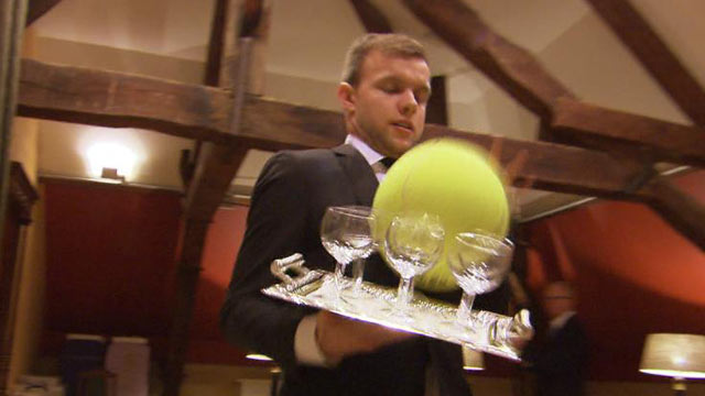 PHOTO: At International Butler Academy, large tennis balls are used to teach students to carry full trays in crowded rooms.