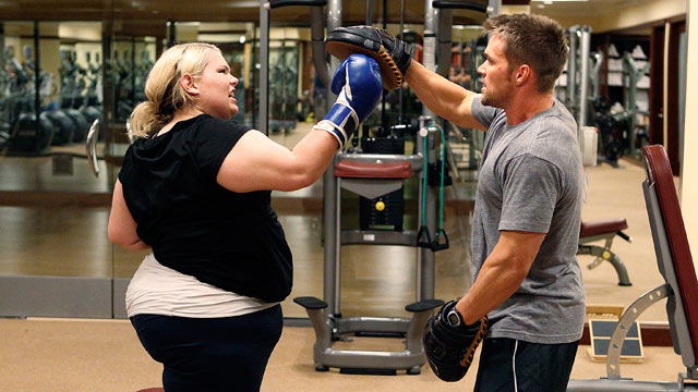 "PHOTO: Chris Powell, right, is shown training a participant on ""Extreme Makeover: Weight Loss Edition."""