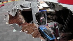Security camera footage captures a sinkhole collapse part of the National Corvette Museum in Kentucky.
