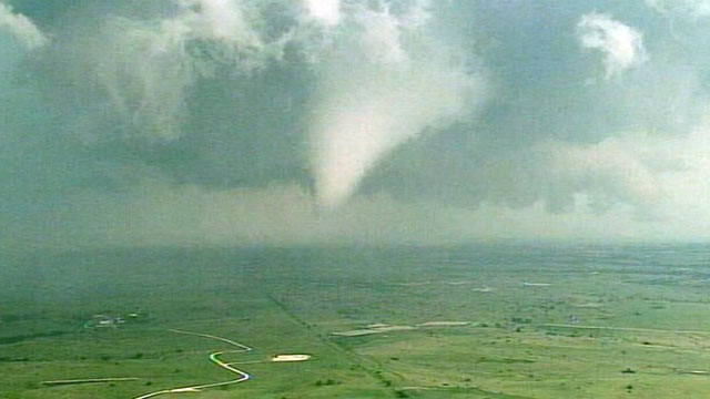 PHOTO: Dark storm and funnel clouds form over Dallas, Texas on April 25, 2011.
