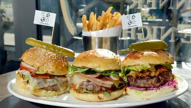 PHOTO: DBGB's restaurant offers a &quot;menage  trois&quot; Burger dish, including 3 different burgers, The Yankee, The French and the Piggy, New York City, July 25, 2012.