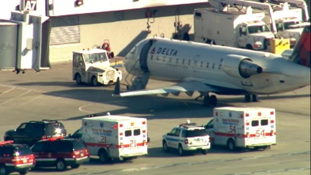 A Delta flight was under quarantine at Chicago Midway Airport, April 26, 2012. Police and paramedics surrounded the plane on the tarmac. (ABC News)