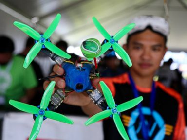 PHOTO: Ken Loo holds his custom built drone at the National Drone Racing Championships on Governors Island, Aug. 5, 2016 in New York.