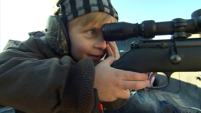 PHOTO: Four-year-old Gage Butler aiming his .22-caliber rifle. The Butlers have been shooting guns for generations.
