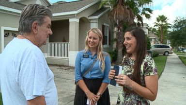 Sister Krieberg (center) and Sister Thomson (right) talk to a resident in the Orlando area about the Mormon faith.