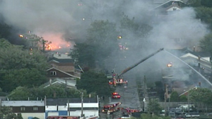 PHOTO High winds are fueling fires burning at dozens of homes in multiple neighborhoods throughout the city of Detroit.