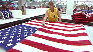 PHOTO Star by patriotic star, stripe by patriotic stripe, workers at Miamis Goodwill Industries stitch and sew the most familiar of flags.