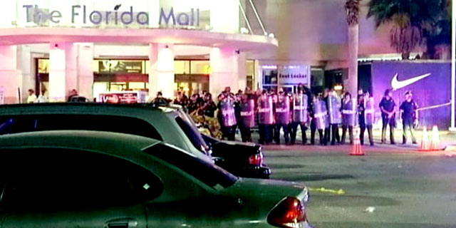 PHOTO: Law enforcement officers pulled out riot gear to control a mob of people who became unruly outside the Florida Mall after the release of a new pair of basketball shoes was canceled.