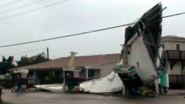 VIDEO: Irene?s winds rip off a gas stations canopy, throwing metal in all directions.
