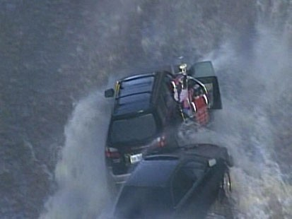 VIDEO: Emergency crews rescue stranded commuters from their cars.