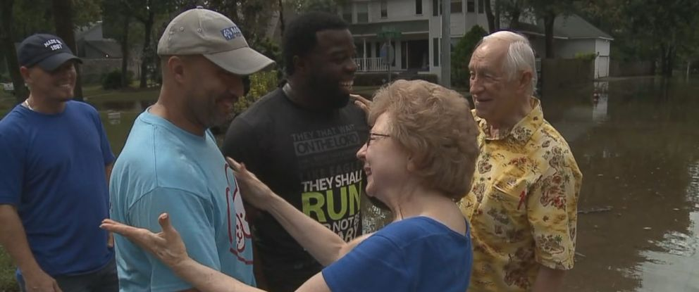 Karen and J.C. Spencer, reunited with Keith Christensen and Winston Savice, Jr., the men who rescued them by jet ski after Hurricane Harvey.