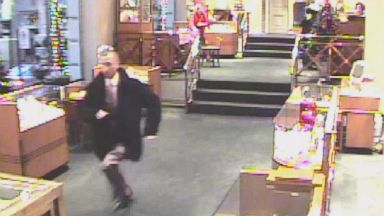Victor Lupis is seen here on surveillance video running out of the David Marguilis jewelry store in Portland, Oregon in December 2010.