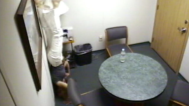 PHOTO: Footage from the police precinct where Jodi Arias was being questioned shows her do a headstand in the interrogation room, left.