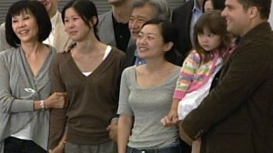 In a tearful welcome home, American journalists Euna Lee and Laura Ling were greeted by their families as they arrived back in the United States this morning after 148 days of imprisonment in North Korea. The two were followed by former President Bill Clinton, whose landmark trip to the elusive nation secured the two's release.
