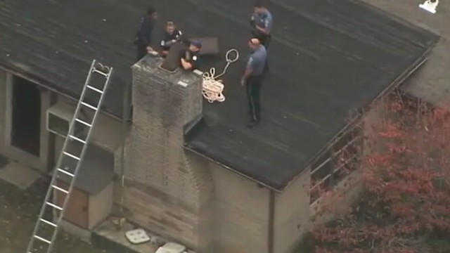 VIDEO: Georgia police take teen stuck in chimney for more than 10 hours into custody.
