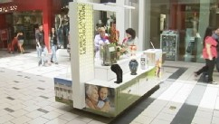 VIDEO: Funeral Kiosk Lures Mall Patrons