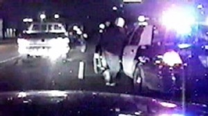 Video: Suspect caught on tape stealing police car.
