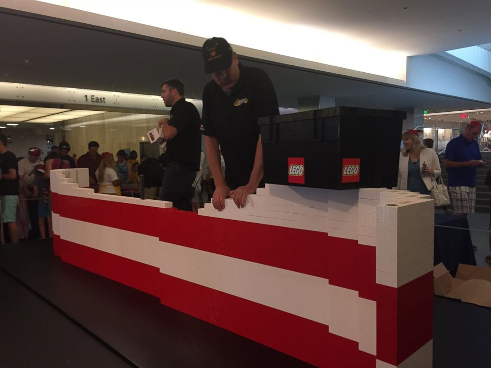 Just in time for july 4 kids construct largest american flag made of legos abc news - Lego brick caravan a record built piece by piece ...