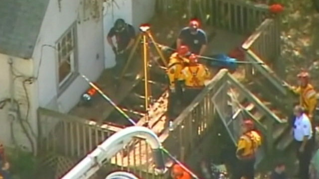 PHOTO: Emergency workers search for Baby Lisa Irwin in a well under a deck behind a vacant home in Kansas City, Mo., in this photo taken from aerial footage, Oct. 11, 2011.