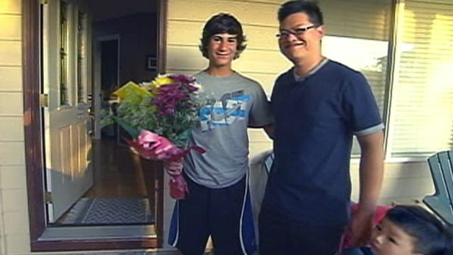 PHOTO: Marcos Ugarte, 14, left, greets Alex Ma, the father of the young boy he saved from a burning home in Troutdale, Ore.