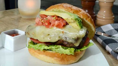 PHOTO: The Southwestern Burger is a great splurge option at MARX restaurant, served with truffle parmesan french fries and blueberry cocktail, July 20 2012.