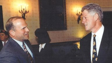 PHOTO: Col. Tim Milbrath with former President Bill Clinton.
