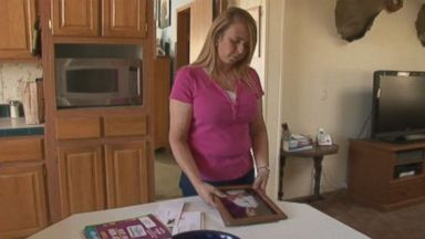 PHOTO: Dana Campbell is shown here looking at a photo of her son, Matthew Campbell.