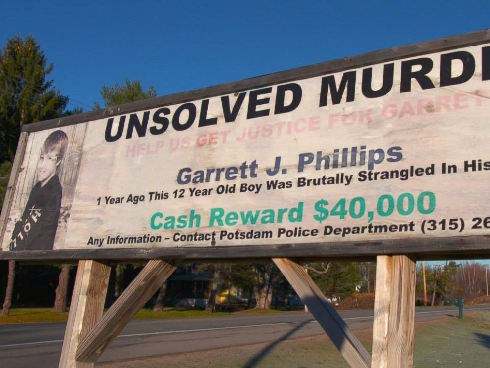 PHOTO: Unsolved murder sign for Garret Phillips in Potsdam, New York.