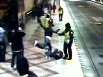 Guards watch as teen is beaten