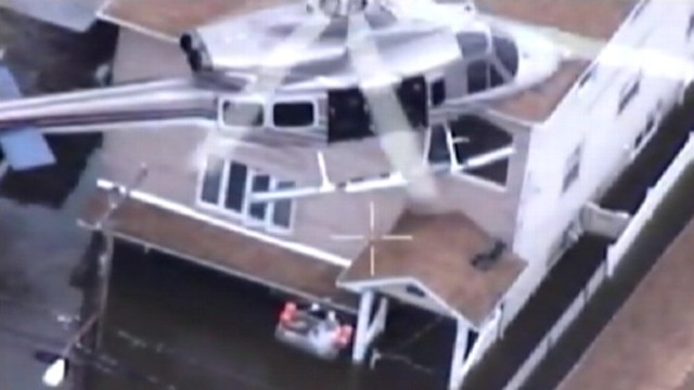 VIDEO: Helicopters save five adults and one child who were trapped in their Staten Island, N.Y., homes.