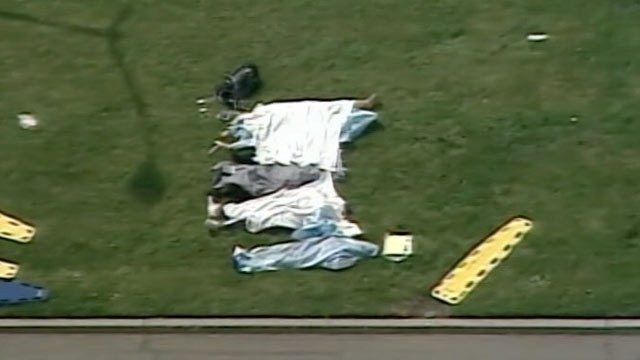 PHOTO: The bodies of victims lay outside of Oikos University in Oakland, Ca. where as many as eight people may have been shot, April 2, 2012.