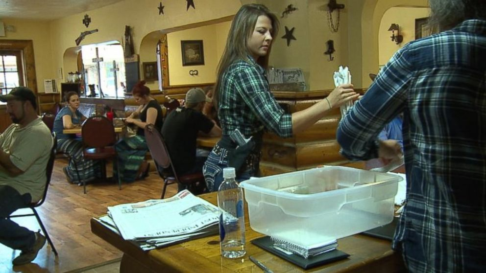 PHOTO: Most of the wait staff at Shooters Grill in Rifle, Colorado, open carry handguns.