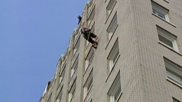 PHOTO: Group repels down a 12-story building to raise money for YMCA