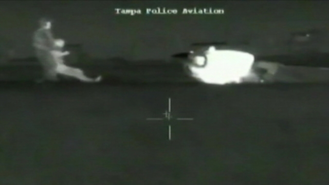 VIDEO: Tampa police officers respond to an aircraft distress call, pulling the pilot to safety.