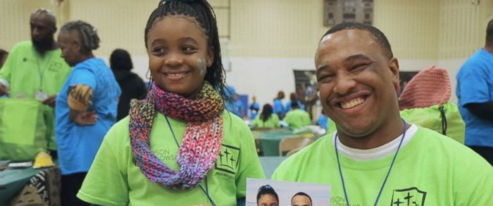 "Arkinya Graham, 8, is shown here with her father Johnny ""Trey"" Williams during the One Day with God program at Earnest C. Brooks Correctional Facility in Muskegon, Michigan."