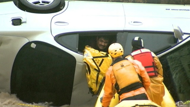VIDEO: A rescue team in Boulder County, Colo., saved a driver who was trapped in Rock Creek.