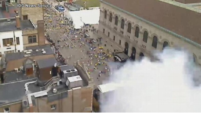 VIDEO: Rooftop camera captures a plume of smoke from one of the marathon's explosions.
