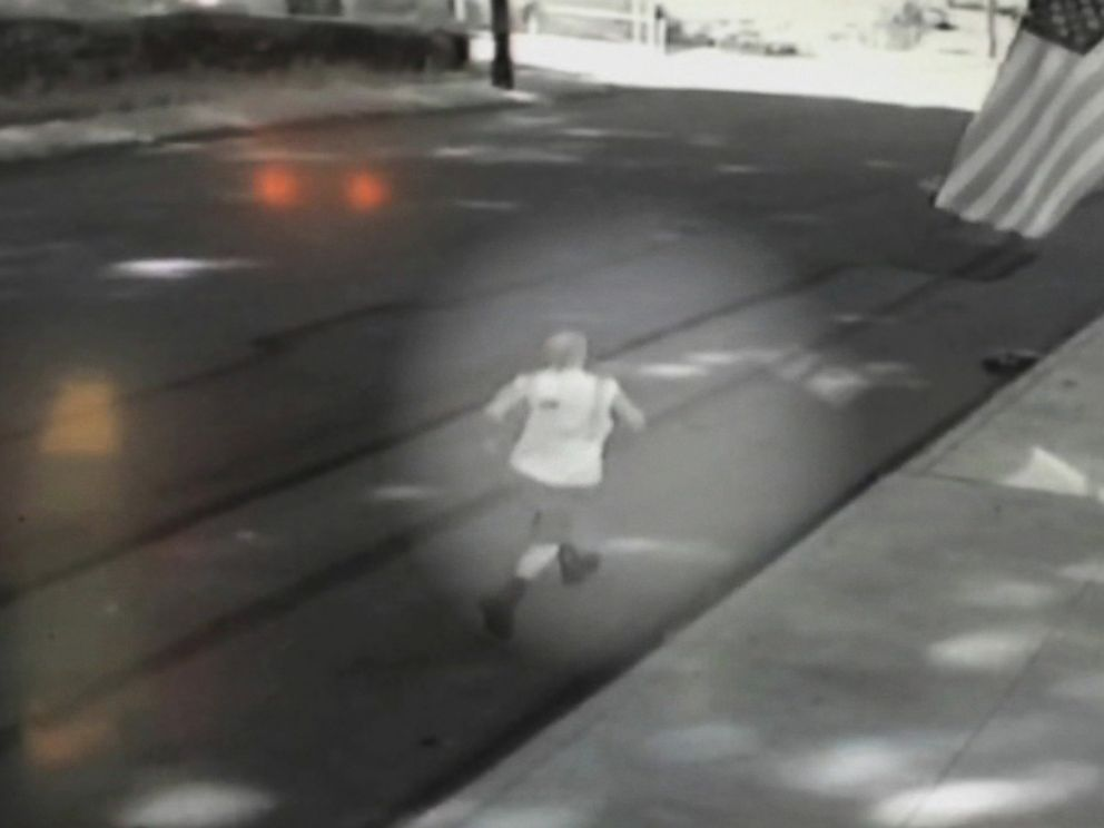 PHOTO: Footage from a surveillance camera shows the waste management worker running following an unmanned garbage truck which smashed into no less than 5 cars on July 31, 2015 inside Beaver County, Pa.
