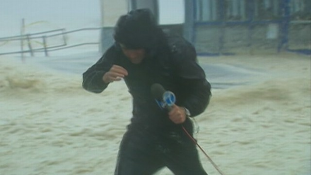 VIDEO: Heavy winds, rain and sea foam weren't enough to deter journalists from covering the story.